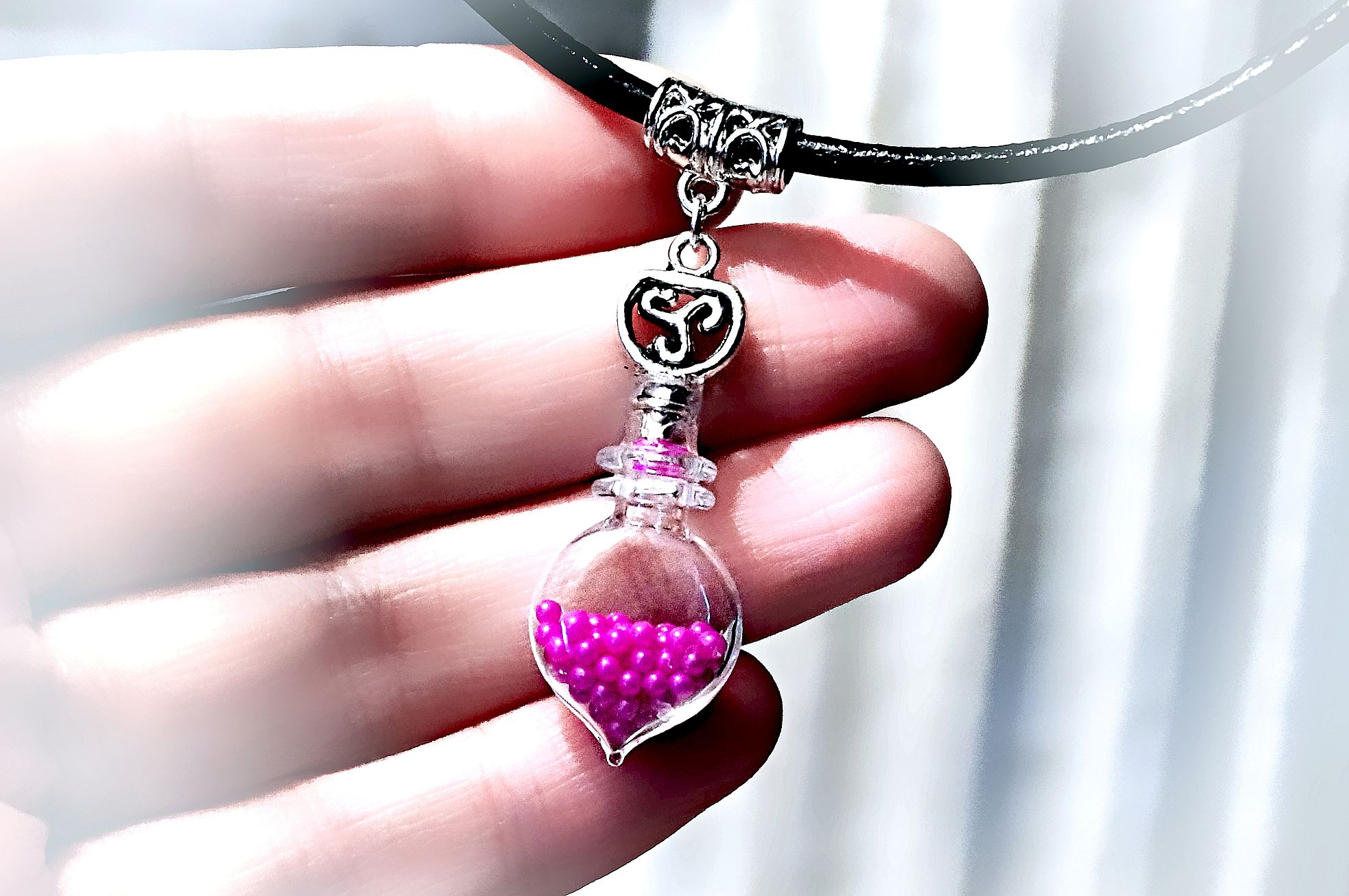 triskele bdsm symbol bottle necklace