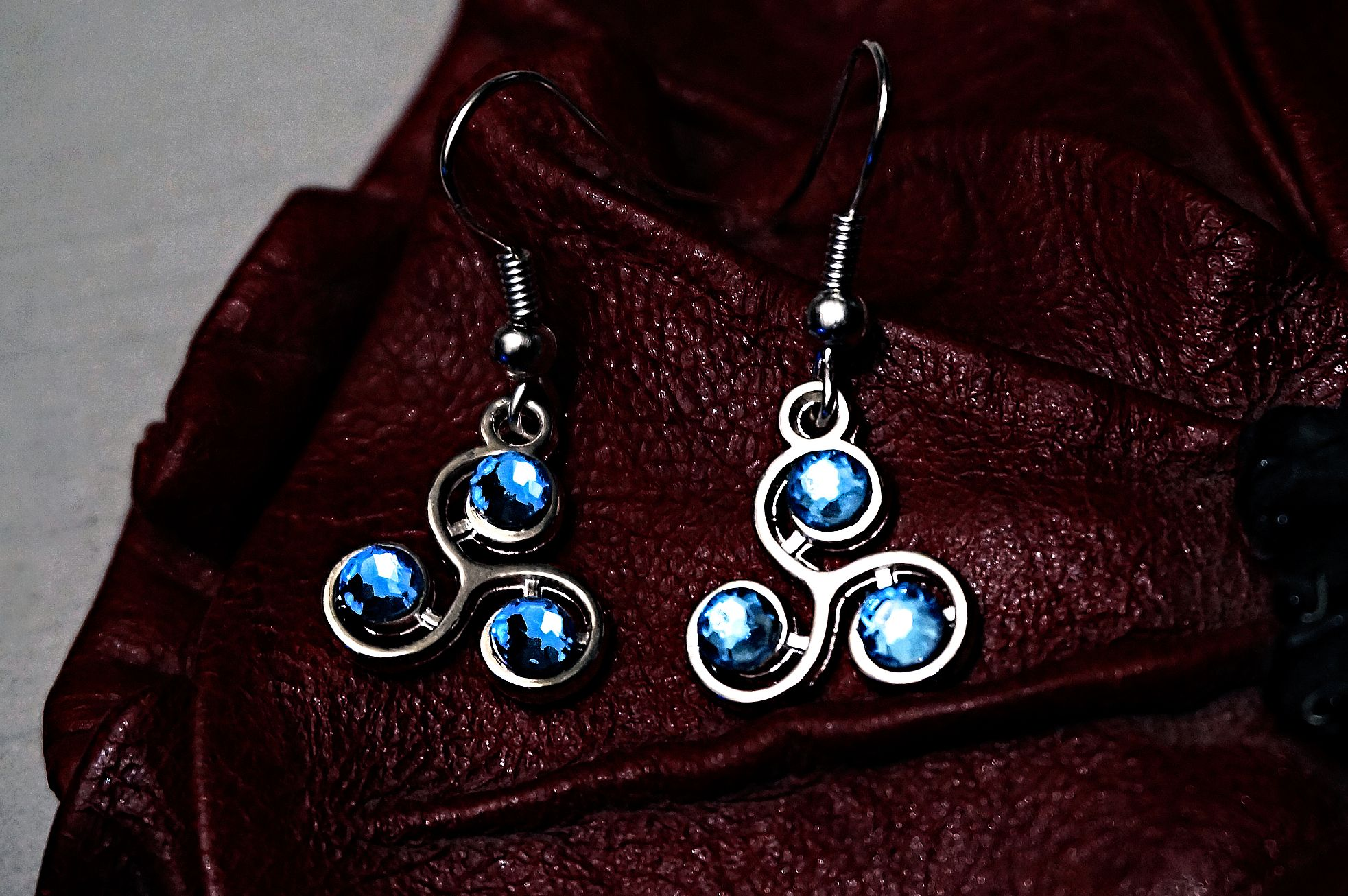 Triskele emblem earrings submissive slave